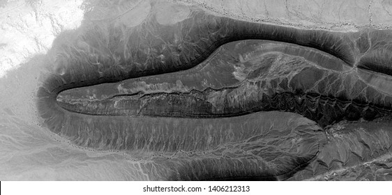 fossil of pterosaur, allegory, abstract naturalism, Black and white photo, abstract photography of landscapes of the deserts of Africa from the air, aerial view, contemporary photographic art,