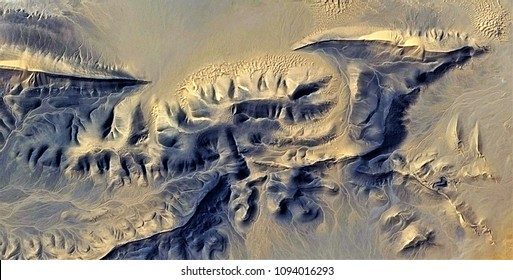 fossil of Pterosaur, metaphor,  abstract photography of the deserts of Africa from the air, aerial view, abstract expressionism, contemporary photographic art,