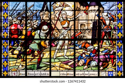 FOUGERES, FRANCE - Aug 12, 2018: Stained glass window representing Joan of Arc after the Siege of Orleans, Eglise Saint-Sulpice church