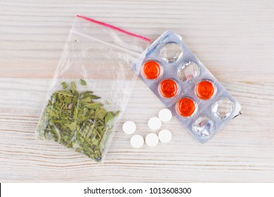 found during a police search of the unknown herbal mixtures and preparations are subject to further research different pills and a package of Smoking mixture