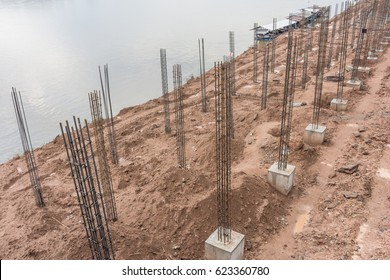 Foundation Building cement pillar in retaining wall construction site