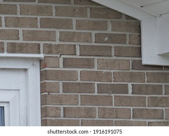 Foundation cracks in brick mortar concrete of house or building caused by house settling over time or by earthquake