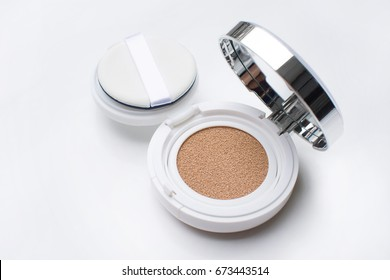 foundation cushion with sponge and puff, white background