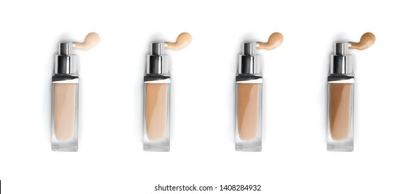 Foundation face make-up samples. Set of cosmetic liquid foundation or bb cream in bottle different colour smudge smear strokes. Make up smears isolated on a white background. Foundation colors palette