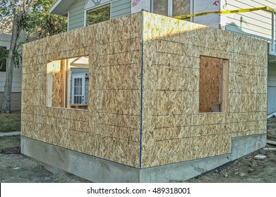Foundation and first floor of home addition framed and covered with osb (oriented strand board)