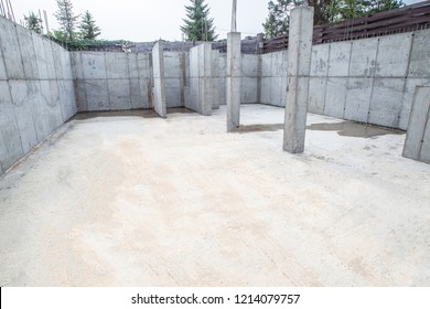 The foundation of the house. Pouring the foundation. Construction works. Construction site Walls of concrete. Concrete foundation.
