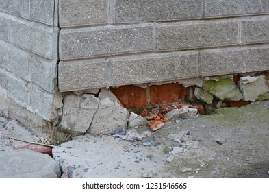 Foundation house wall damage from wetness. Foundation walls without waterproofing. Cracked foundation wall corner.
