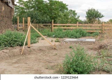 The Foundation for mount wooden fence. Foundation for the fixing the rural fence in the ground.