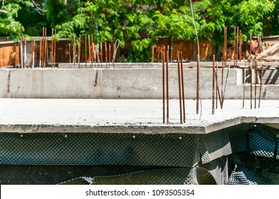Foundation of the new house with reinforcement concrete and steel bars close up of construction site
