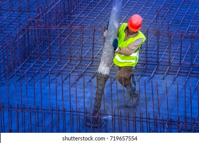 Foundation pouring. Pouring concrete. The worker pours concrete into the foundation.