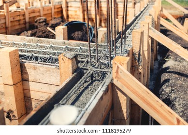 Foundation site of new house, building, details and reinforcements with steel bars and wire rod, preparing for cement pouring
