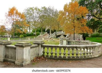 Fountain area with autumn trees in a park in Dijon, France