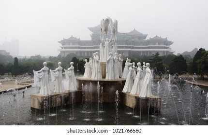 a fountain of dancing women from white stone in the front of the Great Library In the capital of North Korea, Pyongyang
