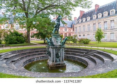 The Fountain of Diana in the garden of Chateau Fontainebleau in Fontainebleau, France.