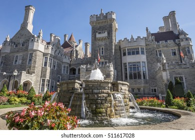 A fountain flows in front of Casa Loma in Toronto Canada.