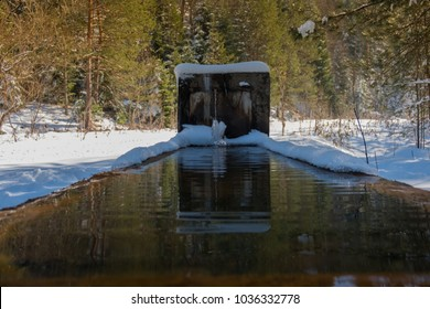 Fountain in the forest and snow