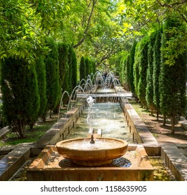 Fountain in the gardens of Hort del Rei near The Almudaina and the Cathedral of Palma de Majorca - Spain