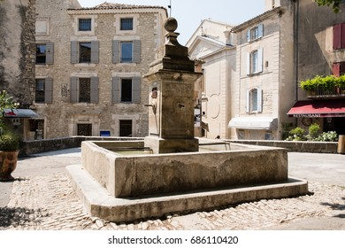 Fountain in Gordes Square, Luberon, Provence, France, set of a movie