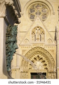 Fountain as a head of Bacchus on a background a gothic church