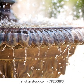 Fountain with high shutter speed to freeze water drops in air