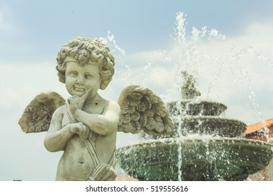 Fountain little cupid angel in the garden