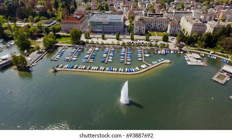 Fountain And Luxury Marina Boats In Zurich Aerial View
