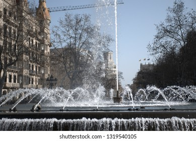 Fountain in the middle of street in Barcelona city