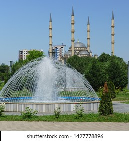 Fountain and minarets of the mosque Heart of Chechnya in the center of Grozny. Sunny summer day
