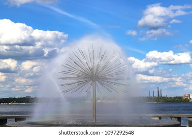 Fountain  near the river  Dnipro against the backdrop of beautiful clouds,  Dnepropetrovsk (Dnepr city), Ukraine