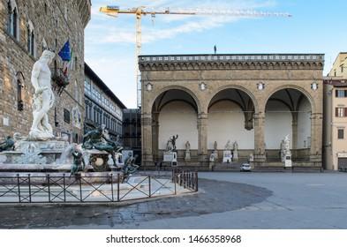 The Fountain of Neptune and the Loggia dei Lanzi (Loggia della Signoria)  on the Piazza della Signoria in Florence, Italy