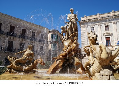 fountain in the old town of siracusa, sicily
