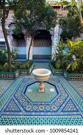 a fountain on the background of traditional Moroccan patterns on the floor in the garden