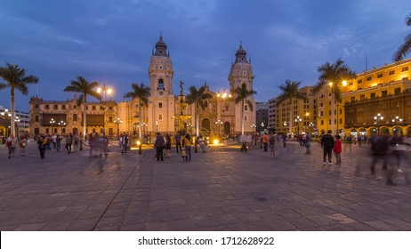 Fountain on The Plaza de Armas day to night transition timelapse, also known as the Plaza Mayor, sits at the heart of Lima's historic center. Illuminated cathedral on a background