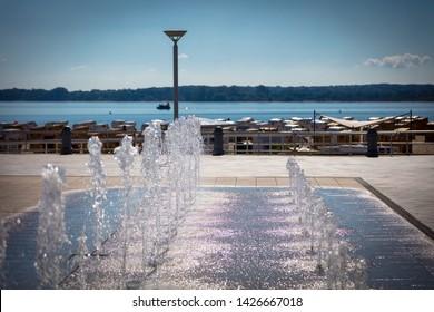a fountain on a promenade on the beach