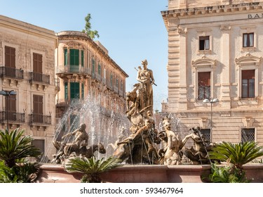 The fountain on the square Archimedes in Syracuse. In the center of the fountain is a magnificent statue of Diana - hunter, surrounded by sirens and tritons. Sicily, Italy