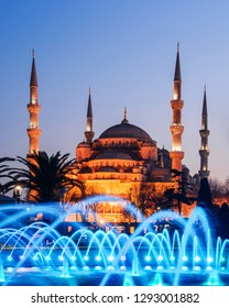 Fountain on Sultanahmet area in evening time. Multicolored streams against the background of the Blue mosque. Located place: Istambul, Turkey