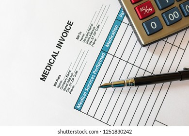 Fountain pen and calculator on Medical Invoice Document