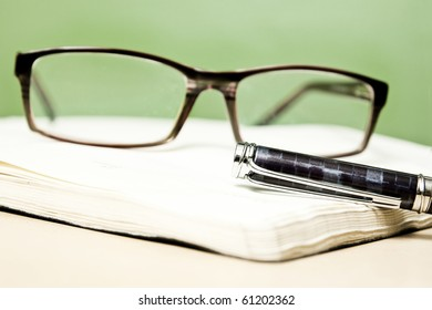 Fountain pen glasses and calendar in composition in color