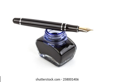 Fountain pen and inkwell over white background