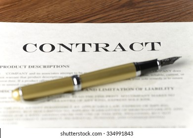 fountain pen laying on a contract