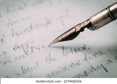 Fountain pen on an ancient handwritten letter. Old story. Retro style. - Shutterstock ID 1574436256