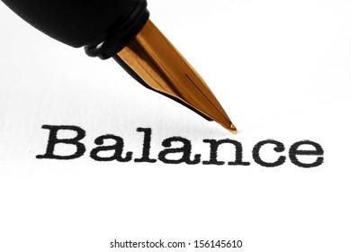 Fountain pen on balance