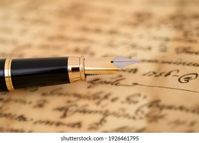 Fountain pen on a blurred  letter background