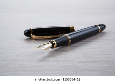 fountain pen on the gray desktop close up