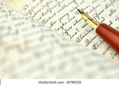 Fountain pen on an old diary