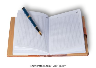 Fountain pen on top of a notebook isolated on white background