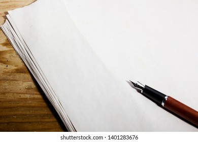 Fountain pen on a white sheet of paper