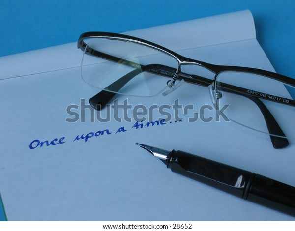 A fountain pen on written paper with glasses.