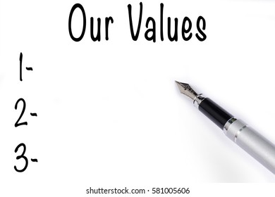 Fountain pen writing the word Our Values on white paper.
