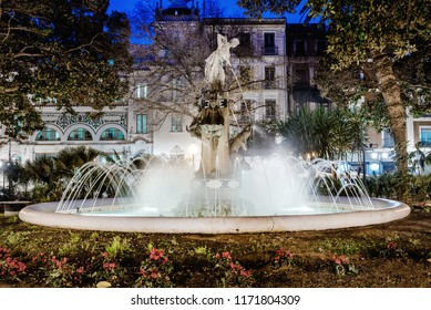 Fountain at Plaza Gabriel Miro square. Sculpture, statue of girl and splashing water illuminated at night. This place is famous, most beautiful in spanish resort city of Alicante. Costa Blanca. Spain